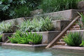 Poolside pool side elaborate decoration and steps Stock Photos