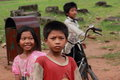 Poor cambodian kids smiling Royalty Free Stock Image