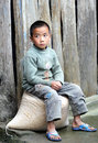 Poor child in the old village in china boy guizhou dong Stock Image