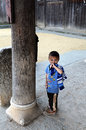 Poor child in the old village in China Royalty Free Stock Photo