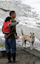 Poor Old man, child and dog in old village, C Royalty Free Stock Photo