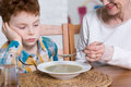 Poor eater and grandmother's dinner Royalty Free Stock Photo