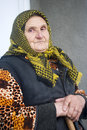 Poor elderly woman of eastern europe Stock Images