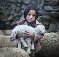 Poor girl from upper shimshal village aniqa karim nickname hakima m keeping a baby goat in his arms gilgit pakistan hakima lives Stock Images