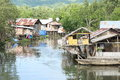 Poor houses above river fishers in sorong papua barat indonesia Stock Photos
