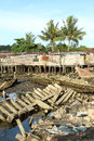 Poor houses and wreckage of boats wooden by sea in mud sorong papua barat indonesia Stock Photo