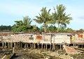 Poor houses and wreckage of boats wooden by sea in mud sorong papua barat indonesia Royalty Free Stock Photography