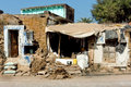 Poor indian family house with broken walls on dirty street Royalty Free Stock Photo
