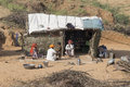 Poor indian family it is located near the huts in the desert. Pushkar, India Royalty Free Stock Photo