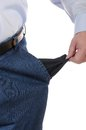 Poor man with empty pockets Royalty Free Stock Image