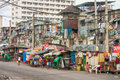 Poor people living in destroyed buildings near the road in mani manila philippines december slums and illegal settlements Royalty Free Stock Photo