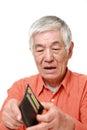Poor senior Japanese man Royalty Free Stock Photo