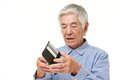 Poor senior Japanese man Royalty Free Stock Photo