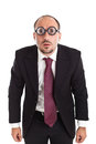 Poor sight businessman staring a wearing thick circle glasses Stock Photography