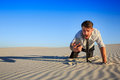 Poor signal. businessman searching for mobile phone signal in desert Royalty Free Stock Photo