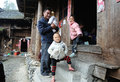 Poor traditional family in the old village in guizhou china father girl kid a chinese falimy dong Royalty Free Stock Photography