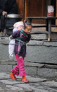 Poor traditional girl who care kid in the old village in China Royalty Free Stock Photo