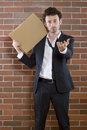 Poor unshaved businessman pleads with a blank sign Stock Photo