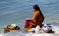 Poor young indian women washing their clothes in a lake Royalty Free Stock Photo