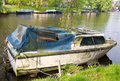A poorly maintained boat dirty looks as if it s in need of repair Royalty Free Stock Images