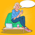 Pop Art Blonde Woman Working with Laptop and Smartphone in a Coffee Shop Royalty Free Stock Photo