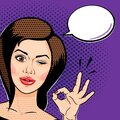 Pop art comics style Playful young woman winking and showing ok sign, thinking bubble for your message. Vector illustration Royalty Free Stock Photo