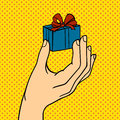 Pop art hand with gift box vector illustration.