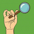 Pop art hand magnifying glass vector illustration.