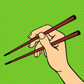 Pop art hand with sushi chopsticks vector illustration.