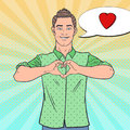 Pop Art Happy Man Showing Heart Hand Sign. Love Comic Style Background