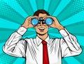 Pop art surprised businessman looking through binoculars. Royalty Free Stock Photo
