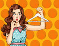Pop Art thinking girl with hanger. Comic woman. girl. Amazed woman.Vintage advertising poster. Royalty Free Stock Photo