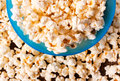 Pop corn cup blue with lot of from above Royalty Free Stock Photography