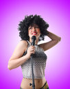 Pop star with mic on white the Stock Photography