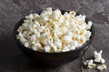 Popcorn a bowl of on a dark background Royalty Free Stock Photos