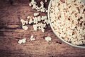 Popcorn a bowl of on a wooden table Stock Photography
