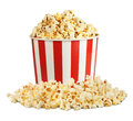 Popcorn in box with pill isolated on white Royalty Free Stock Photo