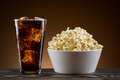 Popcorn and coke on the table Royalty Free Stock Photography