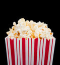 Popcorn container on a black background Stock Photography