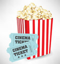 Popcorn container and cinema tickets Stock Photos