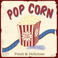 Popcorn with film strip and movie tickets poster on vintage grunge vector illustration Royalty Free Stock Photo