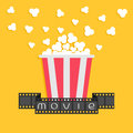 Popcorn. Film strip ribbon. Red yellow box. Cinema movie night icon in flat design style. Yellow background. Royalty Free Stock Photo