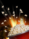Popcorn flying and exploding from red kettle Royalty Free Stock Image
