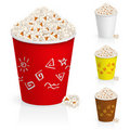 Popcorn in fun multi-colored glasses Stock Photos
