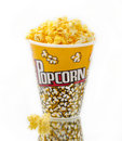 Popcorn on glass with white backgrounder Royalty Free Stock Photos