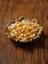 Popcorn kernels in small dish Royalty Free Stock Images
