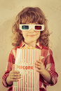 Popcorn kid holding in hands cinema concept retro style Royalty Free Stock Images