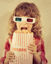 Popcorn kid holding in hands cinema concept retro style Stock Photo