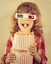 Popcorn kid holding in hands cinema concept retro style Royalty Free Stock Image