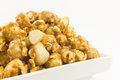 Popcorn with macadamia caramel flavour on white background Stock Images